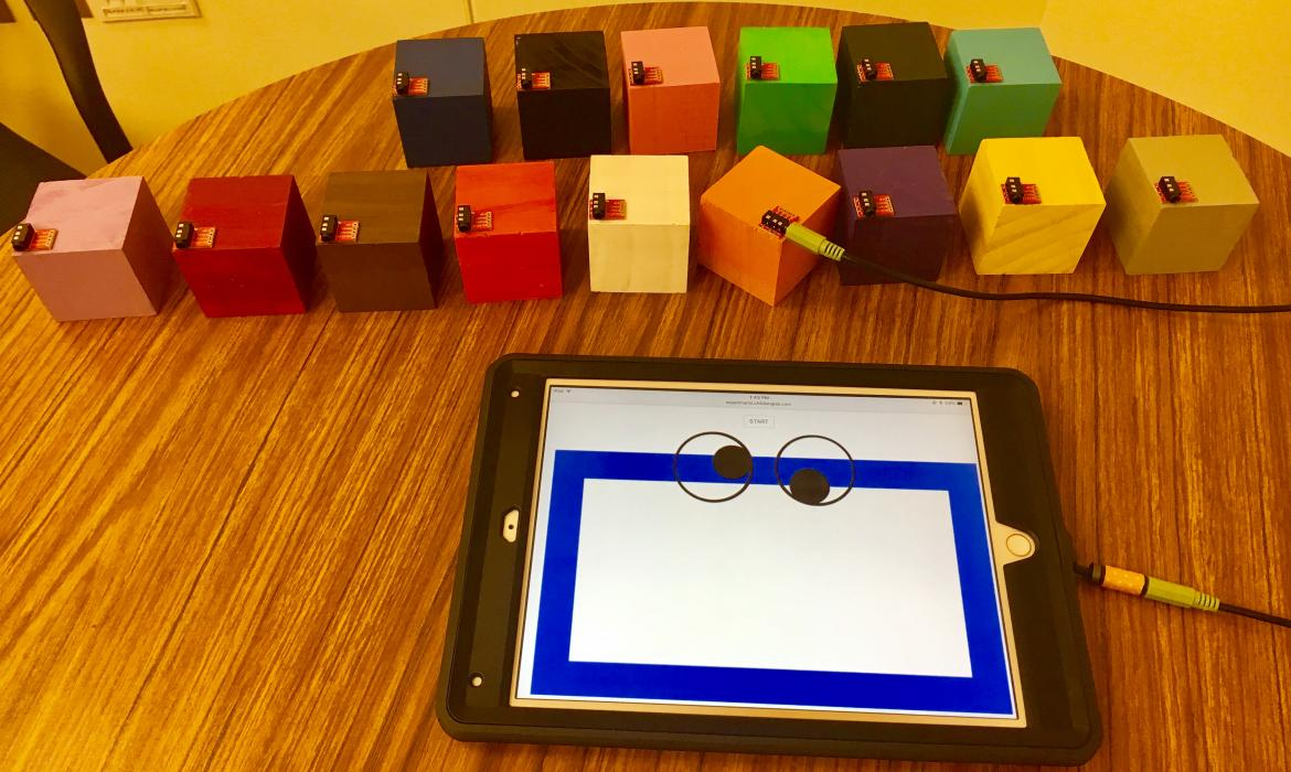 test involving ipad and wooden blocks