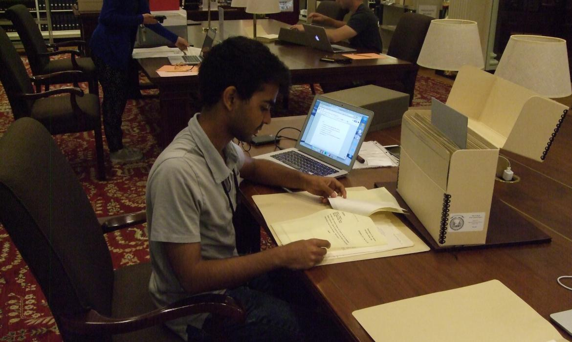 Tathagat working in library