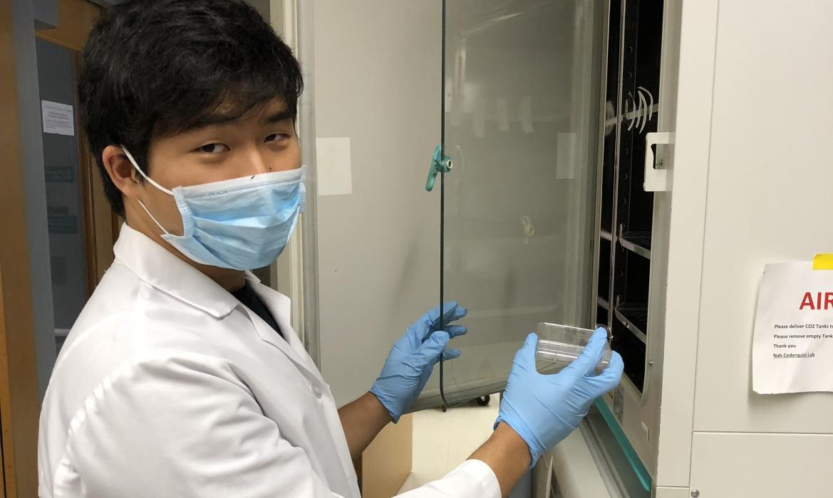 Joseph working in a lab.