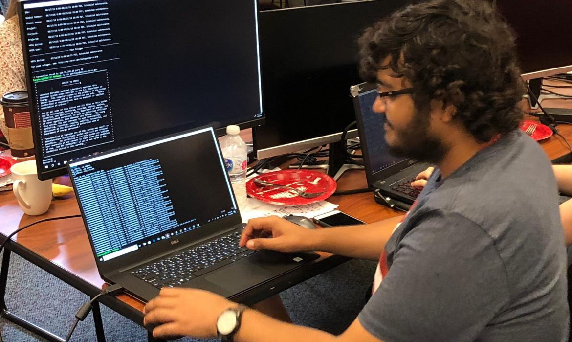Lakshay in front of multiple computer screens