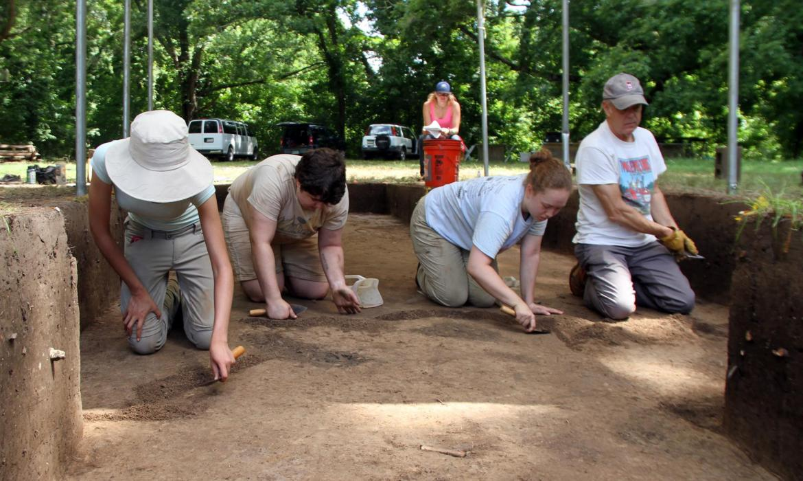 Erin and others on an archaeological dig