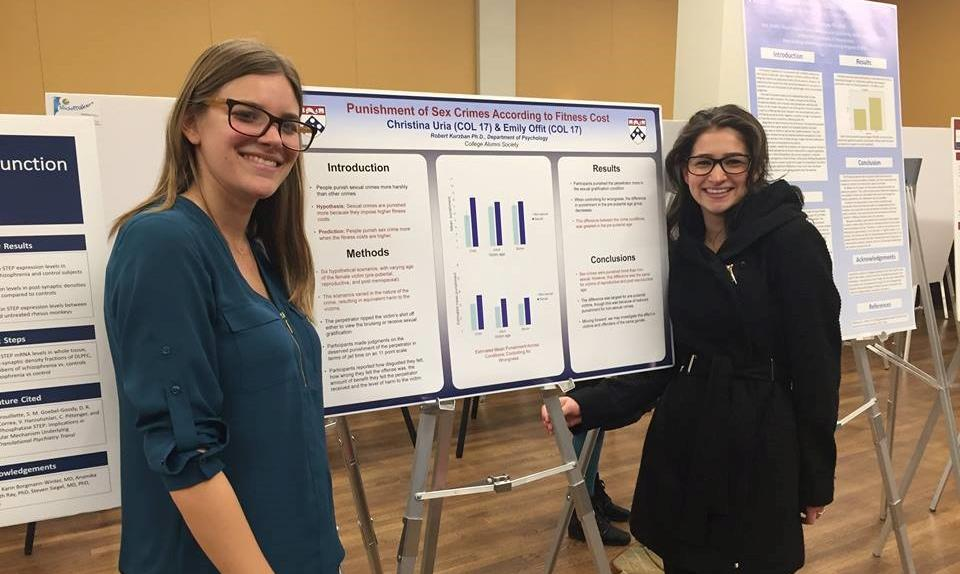 Christina and another student presenting research