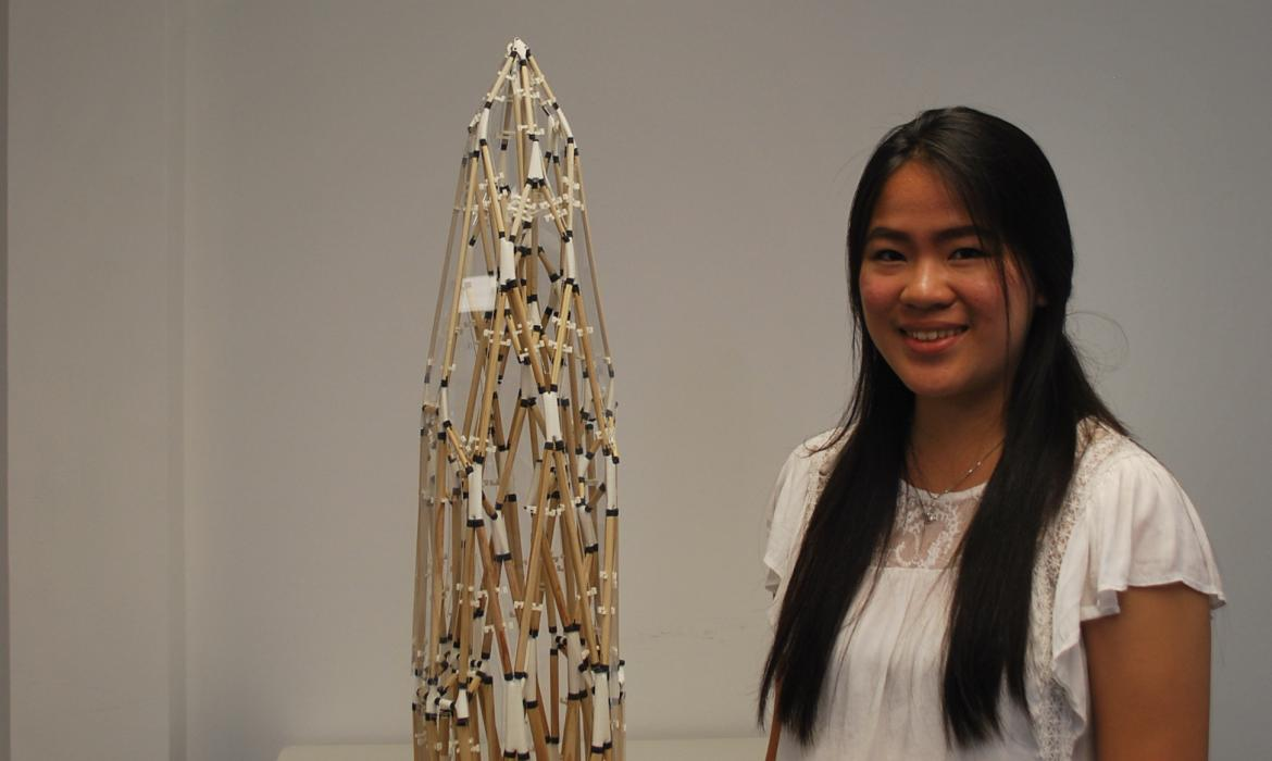 Gabrielle with a physical model of a polyhedral structure