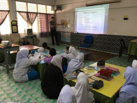Nate teaching in a classroom in Malaysia