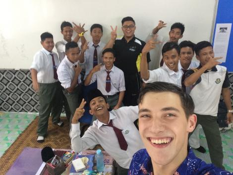 Nate with students in Malaysia